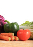 Vegetables on wooden chopping board Royalty Free Stock Photos
