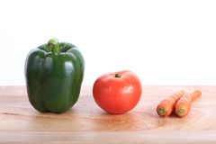 Vegetables on wooden chopping board Royalty Free Stock Image