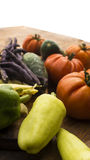 Vegetables on wooden chopping board and table. Several vegetables on wooden surface.High resolution image Stock Photo