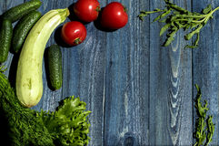 Vegetables on wooden desk Royalty Free Stock Photos