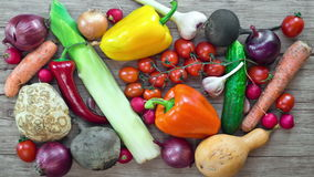 Vegetables   on wooden desk, stop motion animation, 4K stock video footage