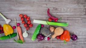 Vegetables   on wooden desk, stop motion animation, 4K stock video