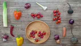 Vegetables   on wooden desk, stop motion animation, 4K stock footage