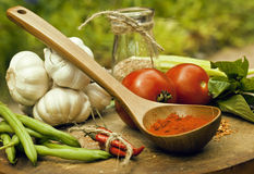 Vegetables on wooden kitchen with spicies, tomato Stock Image