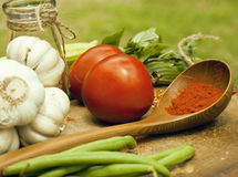 Vegetables on wooden kitchen with spicies, tomato Royalty Free Stock Image