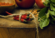 Vegetables on wooden kitchen with spicies, tomato Royalty Free Stock Photography