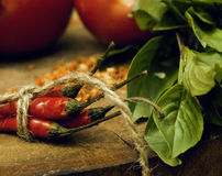 Vegetables on wooden kitchen with spicies, tomato Royalty Free Stock Photo