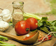 Vegetables on wooden kitchen with spicies, tomato Stock Photography