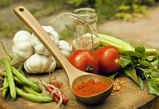 Vegetables on wooden kitchen with spicies, tomato Stock Images