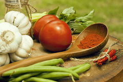 Vegetables on wooden kitchen with spicies, tomato Stock Photos
