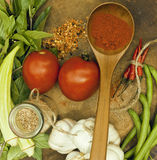 Vegetables on wooden kitchen with spicies, tomato, chilli, green Royalty Free Stock Images
