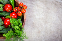Vegetables on wooden plate Stock Photography