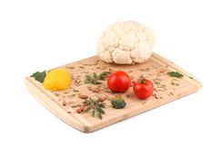 Vegetables on wooden platter. Stock Photography