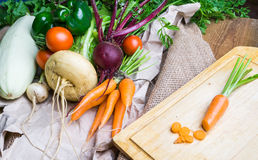 Vegetables on wooden and sackloth background Stock Photo