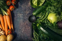 Vegetables and wooden spoon on table Stock Images
