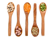 Vegetables on wooden spoons from above Stock Image