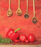 Vegetables and wooden spoons Royalty Free Stock Photos