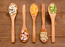 Vegetables on wooden spoons on wood from above Royalty Free Stock Photos