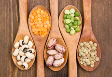 Vegetables on wooden spoons on wood close Royalty Free Stock Photography