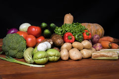 Vegetables on wooden table Royalty Free Stock Photos
