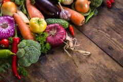 Vegetables on wooden table. Plenty of colorful vegetables on wooden table Royalty Free Stock Photos
