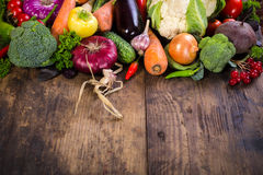 Vegetables on wooden table. Plenty of colorful vegetables on wooden background Royalty Free Stock Photos