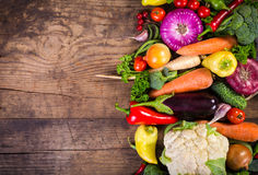 Vegetables on wooden table. Plenty of colorful vegetables on wooden table with copy space Stock Images