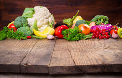 Vegetables on wooden table. Plenty of colorful vegetables on wooden table with empty copy space Royalty Free Stock Photography