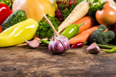 Vegetables on wooden table. Plenty of colorful vegetables on old wooden table Royalty Free Stock Images