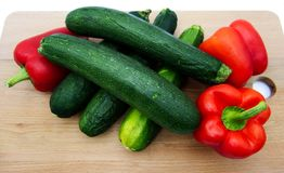 Vegetables on wooden table, zucchini and pepperoni, white background stock photos