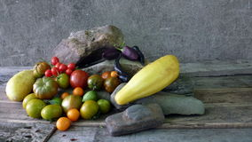 Vegetables. On wooden tables with stone Royalty Free Stock Images