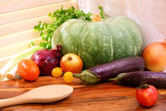 Vegetables on a wooden tray in the sunny day. Country style. Pum Royalty Free Stock Photography