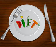 Vegetables The word diet on  plate . vegetarian Stock Photography