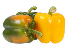 Vegetables of yellow and green pepper isolated on white background Stock Image