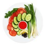 Vegetais com caviar em uma placa Imagem de Stock