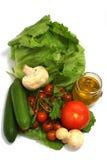 Vegetais com o frasco do petróleo verde-oliva Fotografia de Stock