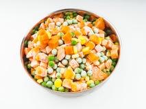 Vegetais congelados na bacia de aço Fotos de Stock Royalty Free