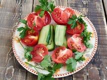 Vegetais cortados em uma placa Imagem de Stock Royalty Free
