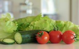 Vegetais da salada na cozinha Fotografia de Stock