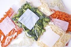 Vegetais desbastados em sacos do congelador Fotografia de Stock Royalty Free