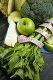Vegetais e frutos verdes - aipo vermelho, brócolis, tiros do aipo Imagens de Stock Royalty Free