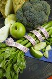 Vegetais e frutos verdes - aipo vermelho, brócolis, tiros do aipo Imagem de Stock
