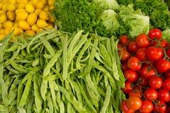 Vegetais e limões Fotografia de Stock