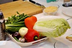 Vegetais em uma placa Fotografia de Stock