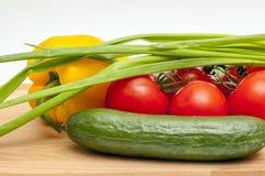 Vegetais em uma placa de estaca Imagem de Stock