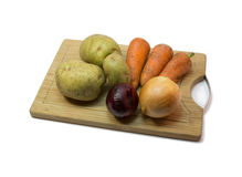 Vegetais na placa de desbastamento Imagem de Stock Royalty Free