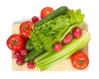 Vegetais na placa de estaca Imagem de Stock Royalty Free