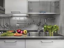 Vegetais no worktop de aço na cozinha Imagens de Stock Royalty Free