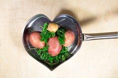 Vegetais saudáveis na frigideira Foto de Stock