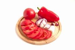 Vegetais vermelhos na placa de madeira Imagens de Stock Royalty Free